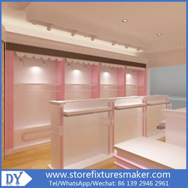 Porcellana Factory OEM Supplier mdf  wooden  in pink white lacquer Baby Girl Clothing Stores display furnitures fabbrica